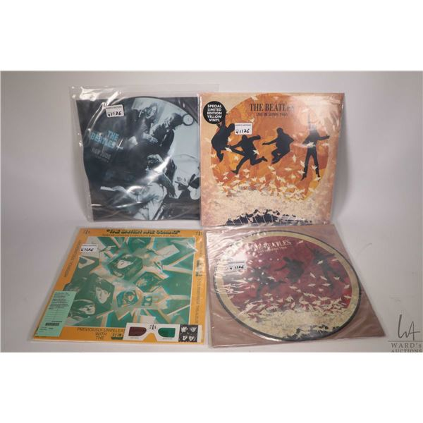 """Four Beatles records including """"Hey Jude"""" picture disc single, a """"Live in Japan 1966"""" pictorial LP ("""