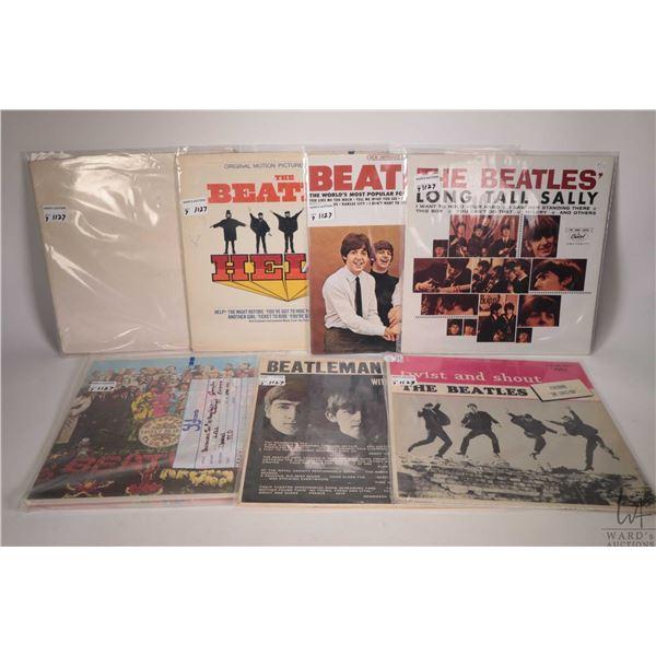 "Seven Beatles LPs including ""White Album"" (black vinyl, UK pressing with poster), ""Help"" (Canadian),"