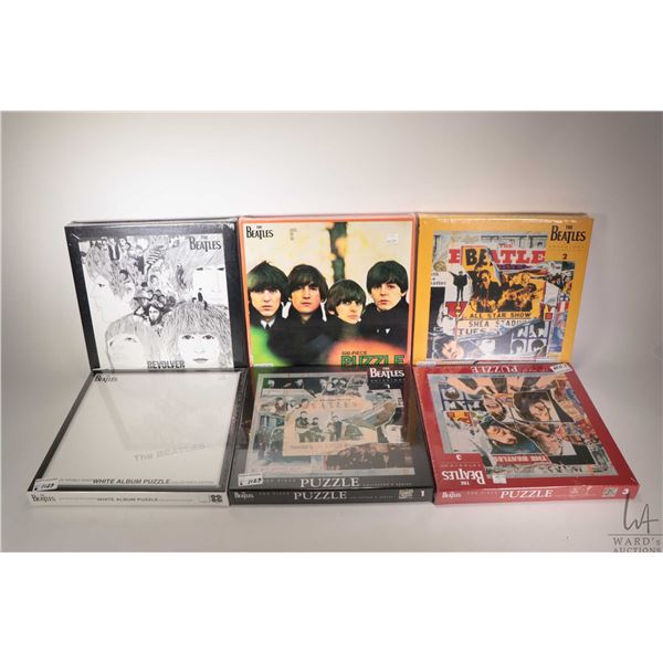 Six sealed Beatles LP themes 500 piece jigsaw puzzles including Revolver, The White Album etc.