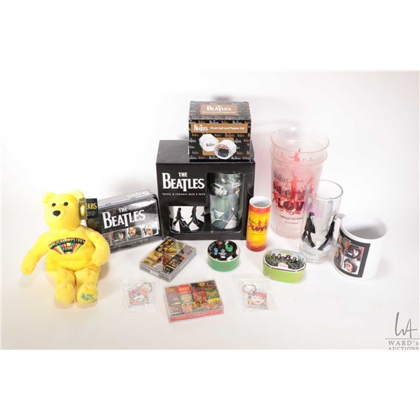 Selection of Beatles collectibles including magnet sets, trinket boxes, cups and mugs, playing cards