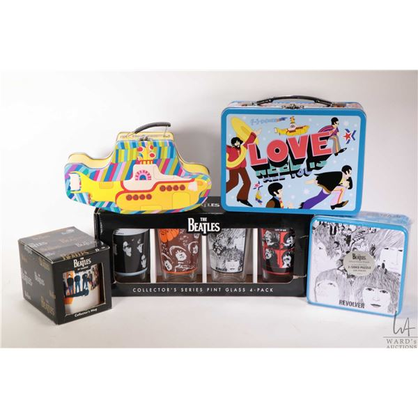 Selection of Beatles collectibles including lunch boxes, factory sealed Revolver puzzle, cup and gla