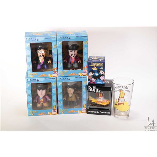 """Selection of Beatles collectibles including Titans 4.5"""" vinyl figures, one of each band member, Yell"""