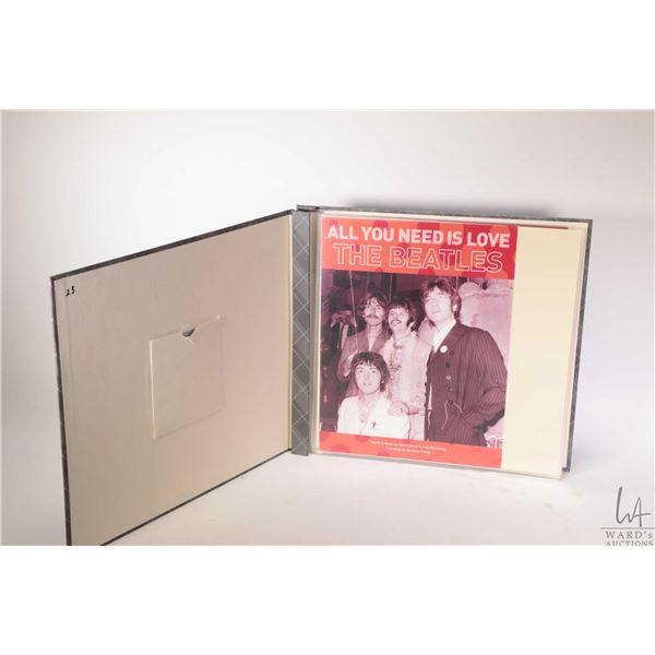 Album containing fourteen Beatles sheet music including Sgt. Peppers, Revolution etc.