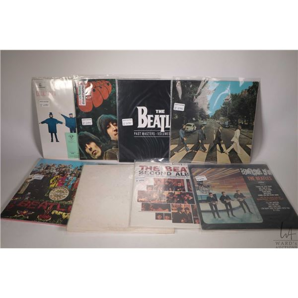 """Eight Beatles LPs including """"Sgt. Peppers"""" remastered, a vintage """"White Album"""", factory sealed """"The"""