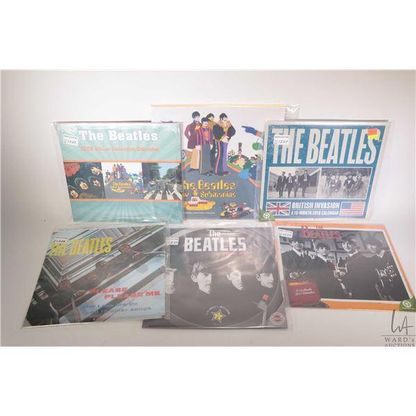 Sixteen Beatles themed wall calendars, assorted years