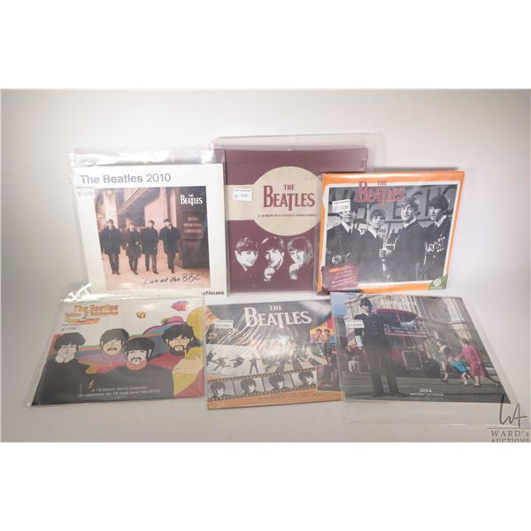 Seventeen Beatles themed wall calendars, assorted years