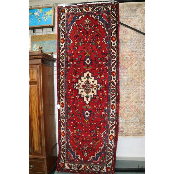 100% Iranian made wool carpet runner with center medallion, geometric stylized floral, red backgroun