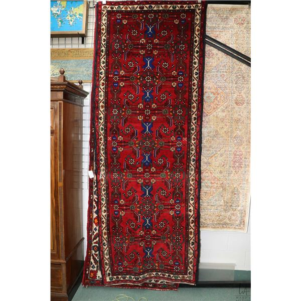 100% Iranian wool carpet runner with overall geometric design, red background and highlights of blue