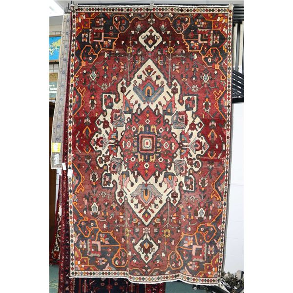 100% Iranian Bakhtiar wool area carpet with center medallion, overall geometric floral in tones of b