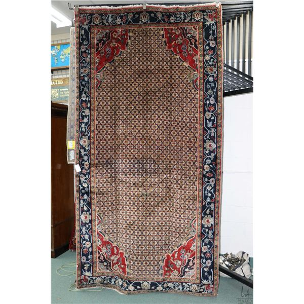100% Iranian Kolyaii wool area carpet with overall geometric design, taupe background and highlights