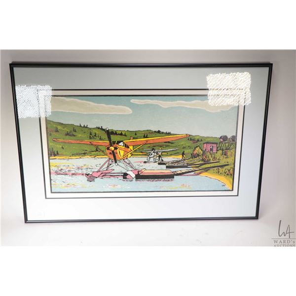 """Framed limited edition print titled """"Float Plane on the Snye"""" and pencil signed by artist Ken North"""