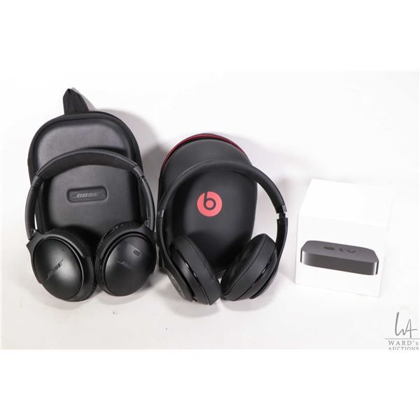 Boxed Apple TV 1080P streaming device, a pair of Beats wireless headphones with case and a pair of B