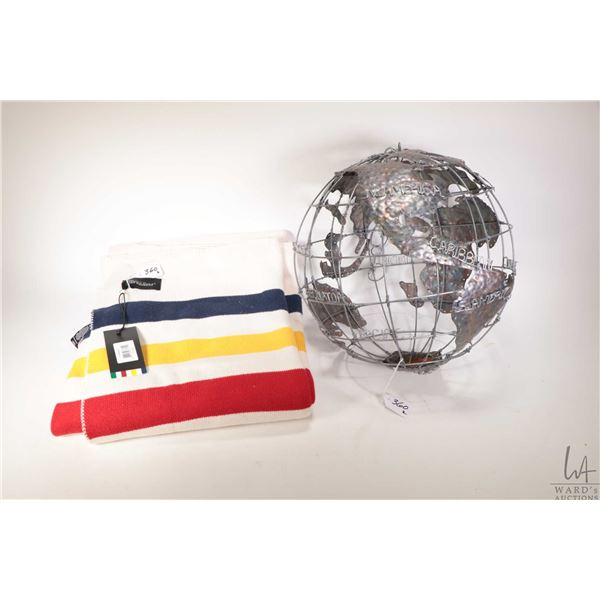 Brand new Hudson's Bay cotton blanket with original hang tag and a hand made metal hanging globe