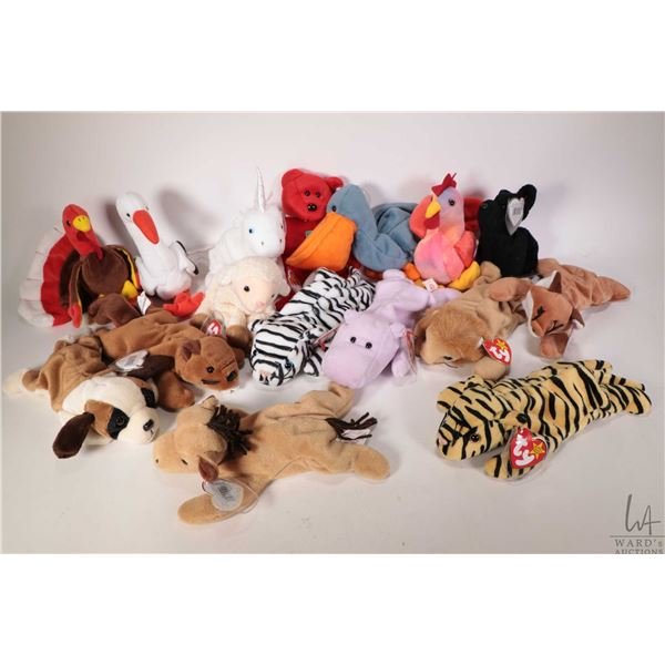 Sixteen collectible Beanie Babies including Ewey the lamb, Blizzard the white tiger, Stripes the dar