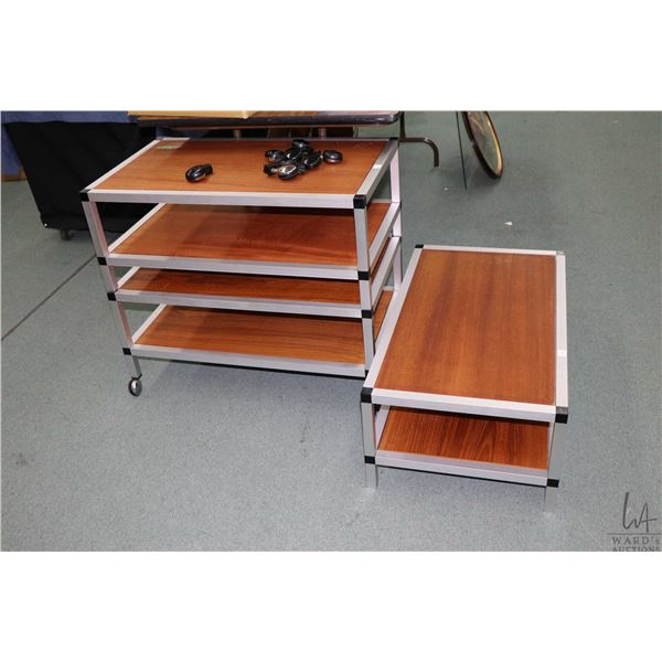 Three teak and aluminum framed rolling two tiered tables on castors