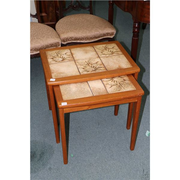 Two Danish teak and tile top nesting tables