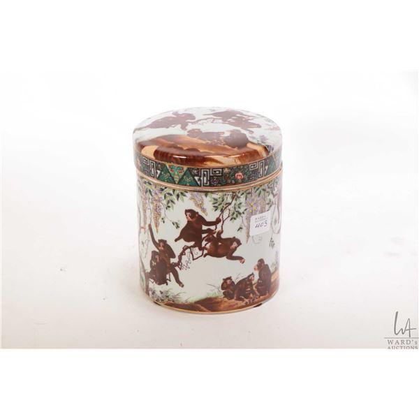 "Hand painted monkey motif lidded tobacco jar, 6"" in height"