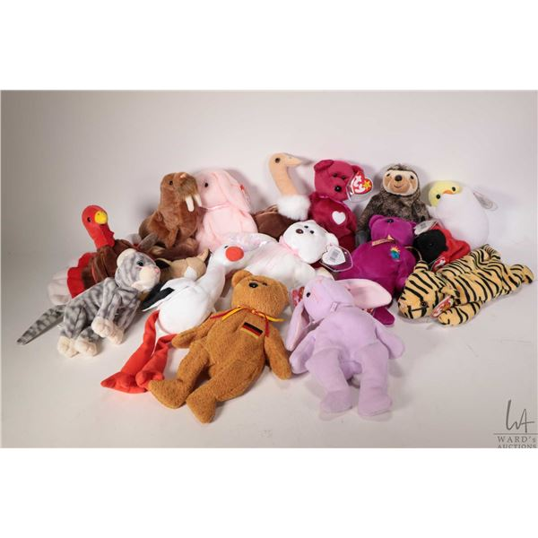 Sixteen collectible Beanie Babies including Halo the angel bear, Germania the German bear, Floppity