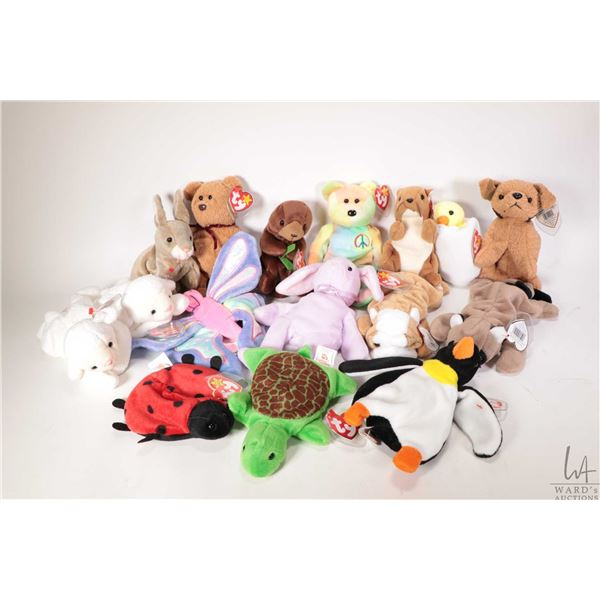 Sixteen collectible Beanie Babies including Ringo the racoon, Wrinkles the bulldog, Lucky the lady b