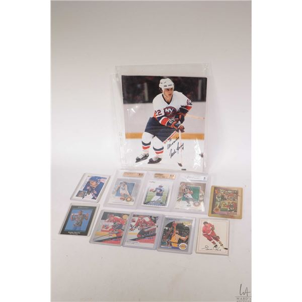 Selection of sports cards including three Beckett graded cards, a Dave Poulin with an error cut etc.