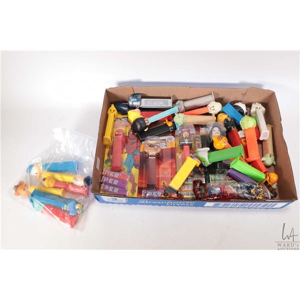 A selection of Pez dispensers and candy, some in original packaging, Spiderman, Star Wars, Cars etc.