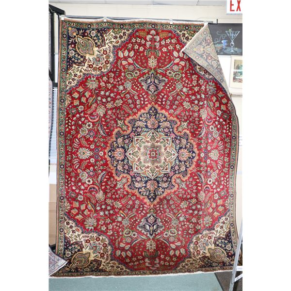 Large 100% Iranian wool area carpet with center medallion, overall floral design, red background and