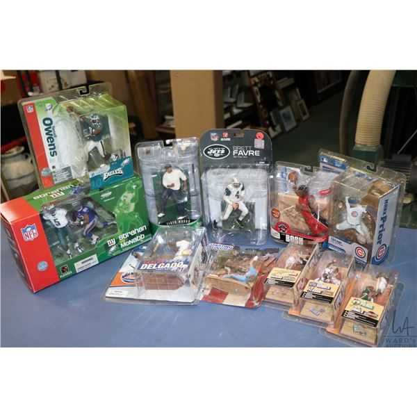 Eleven packaged sports figures including Brent Favre, Terrell Owens, three MBA dual packs, Tiger Woo