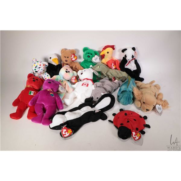 Sixteen collectible Beanie Babies including Millenium the bear, Peace the tie-dyed bear ( Canada), E