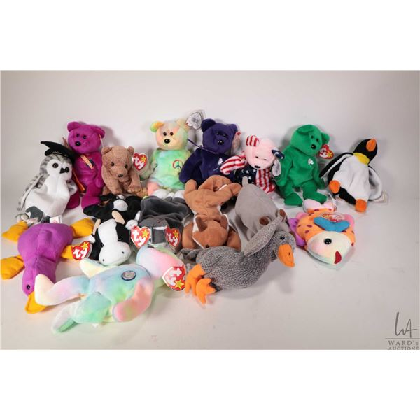 Sixteen collectible Beanie Babies including Pecan the gold bear, Lips the fish, Spike the rhinoceros