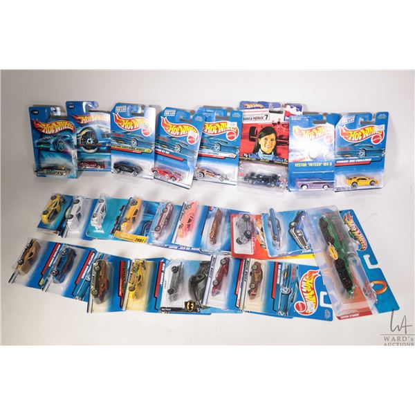 Tray lot of approximately twenty five new in package Hot Wheels including Connectible Super Stoker,