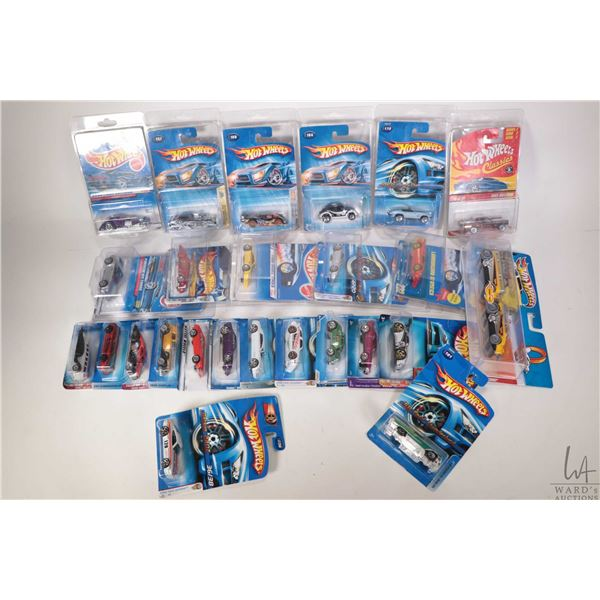 Tray lot of approximatley twenty five new in package Hot Wheels including Scrapheads 5/5, Autonomica