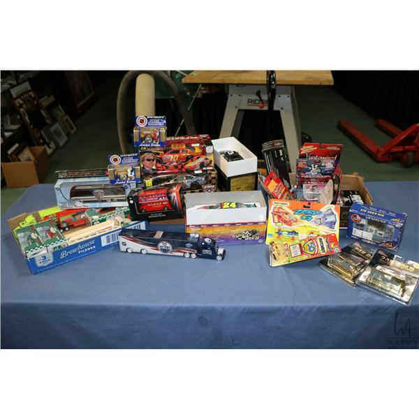 Selection of collectible plastic and die cast cars and trucks including double decker bus, Edmonton