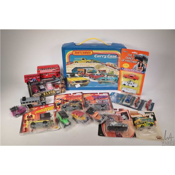 Selection of new in package and used die cast cars and trucks including a Matchbox Carry Case contai