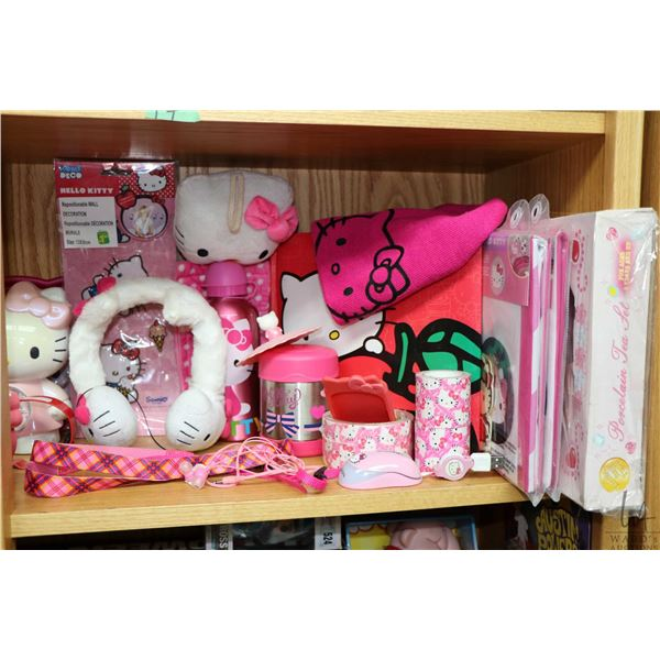 Shelf lot of Hello Kitty collectibles including boxed tea set, new in package pillow cases, stuffies