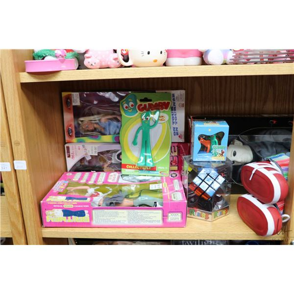 Shelf lot of pop culture collectibles including Britney Spears, Canadian Idol and Spice girls dolls,
