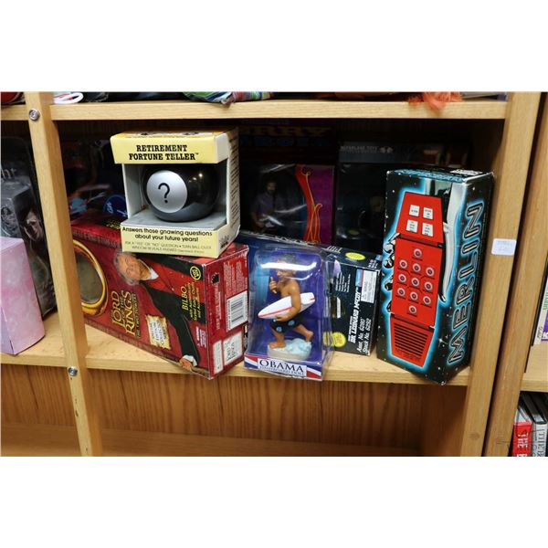 Shelf lot of pop culture collectibles including Kiss band action figures, Maleficent and Marilyn Mon