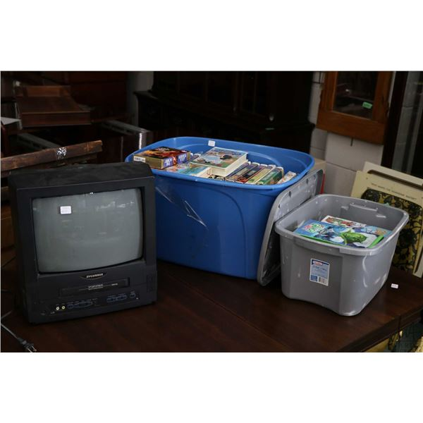 Sylvania tube type television with built in VCR and a large selection of VHS tapes including Walt Di