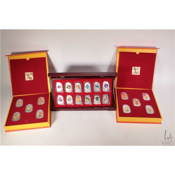 Three boxed Chinese medallion sets including two Season's Greetings and best wishes of the new year,