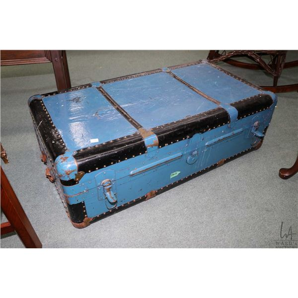 Antique metal bound steamer trunk with tray interior and exterior have been recovered with mack tack