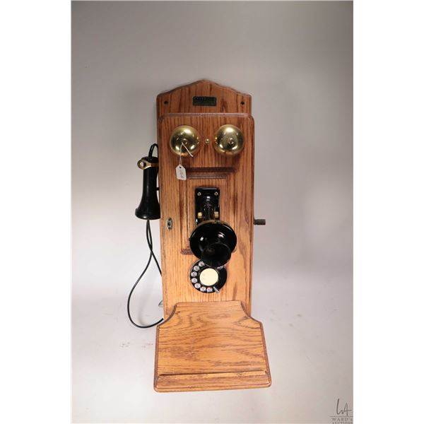 Modern reproduction oak wall mount telephone made by Kellogg Switchboard & Supply Co. Note: Not Avai