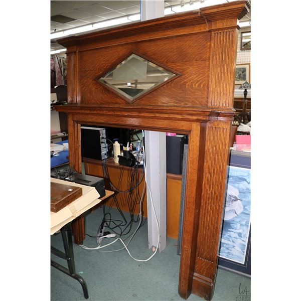 """Antique quarter cut oak mantle with bevelled diamond shaped mirror, 79"""" in height and 68"""" wide, note"""