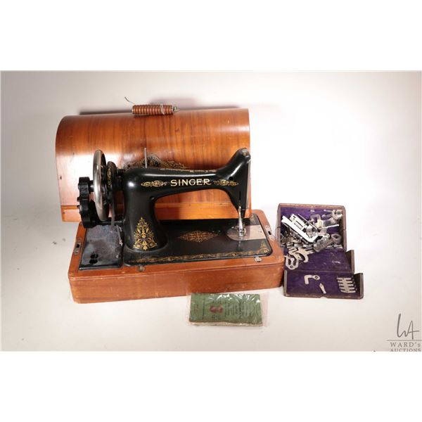 Antique Singer hand crank portable sewing machine in wooden case includes box of sewing machine acce