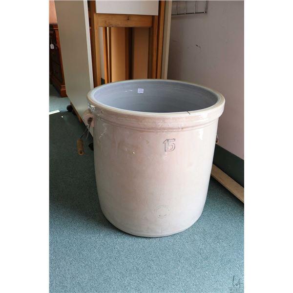 Fifteen gallon Alberta Potteries/Medicine Hat crock with double metal handles, appears in good condi