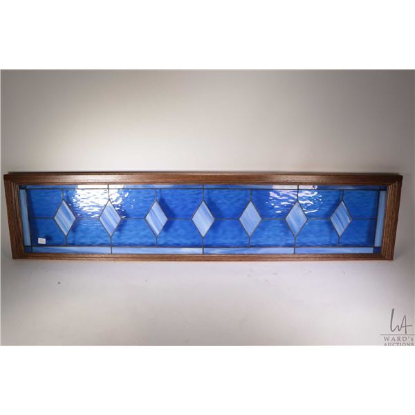 """Vintage diamond motif slag and stained glass panel in wooden frame, 11"""" X 50 1/2"""". Note: Not Availab"""