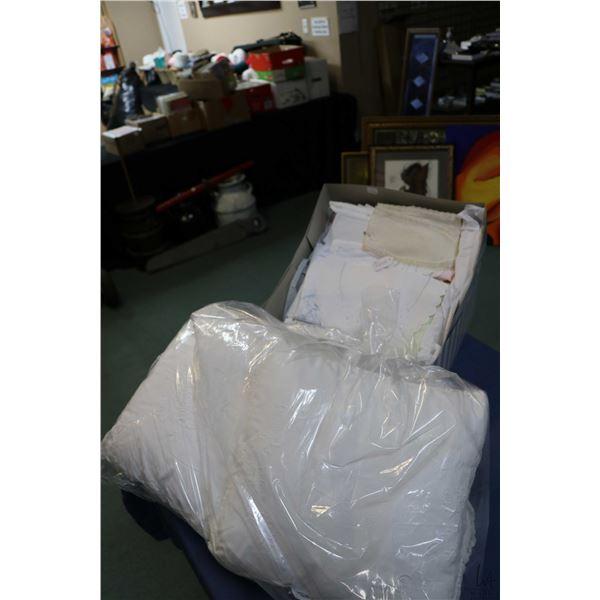 Selection of vintage linens including tableclothes, doilies, napkins, pillow shams, vintage collar a