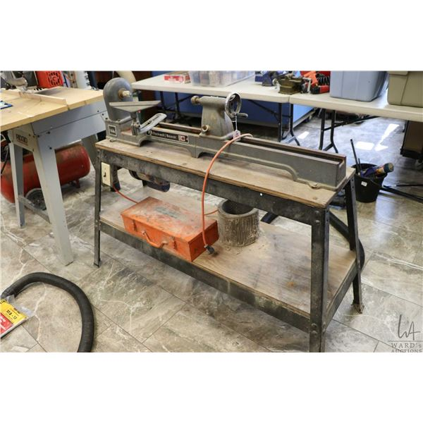 """Rockwell Beaver 36"""" wood lathe and stand, plus a box of lathe tools, motor tested and running"""