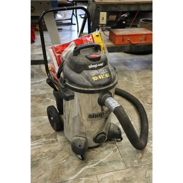 Shop Vac brand Ultra 10 gallon vacuum and accessories and a Mastercraft folding mitre saw stand