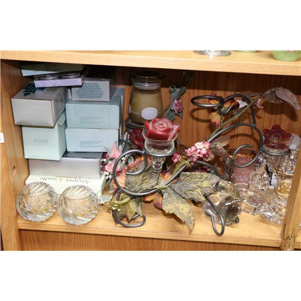 Shelf lot of collectible decor items including two small jade trees, wrought iron candleholders, gla