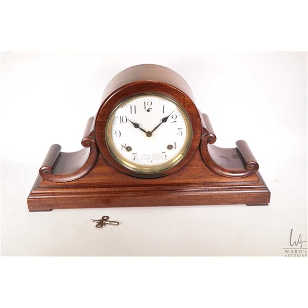 Session mahogany cased chiming mantle clock with key, trying to work at time of cataloguing