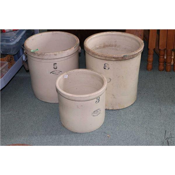 Three stoneware crocks including a five gallon Medalta Potteries, an eight gallon Medalta crock and